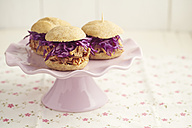 Mini-Burger with pulled pork, red cabbage and fried onions on cake stand - ECF000465