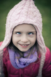Portrati of cross-eyed  little girl wearing winter clothing - SARF000372