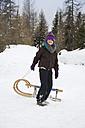 Austria, Carinthia, Gmuend, smiling girl pulling sledge - YFF000069