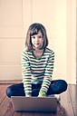 Portrait of little girl with laptop at home - LVF000840