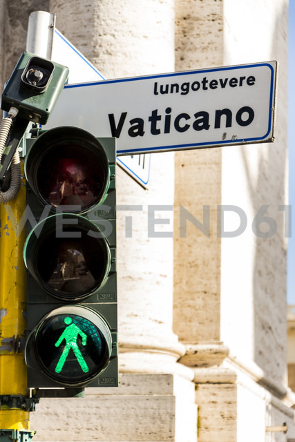 Italy, Rome, Green traffic light and road sign in Vatican City - EJW000371