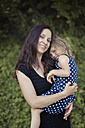 Happy mother holding her daughter outdoors - MW000038