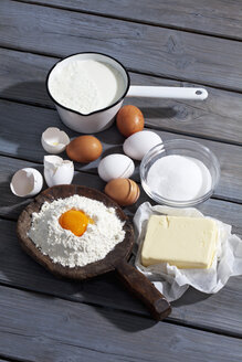Baking ingredients on grey wooden table - CSF021032