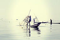 Myanmar, Lake Inle, Fishermen on boats with fish traps - DR000581