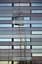 Germany, Bavaria, Munich, facade with reflection of trade fair tower - AX000641