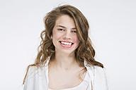 Portrait of smiling teenage girl wearing  lipstick - MAEF008185