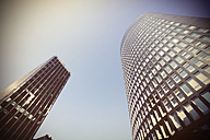 Germany, North Rhine-Westphalia, Dortmund, view to high-rise office buildings from below - HOH000594