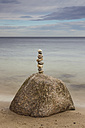 Germany, Brodten, Pile of rocks at beach - SR000441
