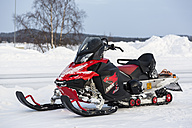 Finland, Inari, Snowmobile at the roadside - SR000388