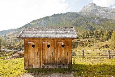Austria, Lungau, outhouses in alpine landscape - KV000057