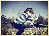 Germany, Baden-Wuerttemberg, girl on a wall - LVF000863