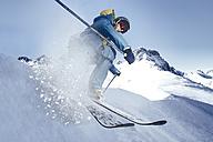 Austria, Vorarlberg, Riezlern, Skier in motion - MUMF000065