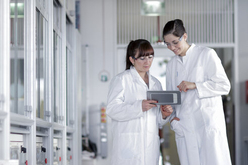 Two young female chemistry students in lab - SGF000464