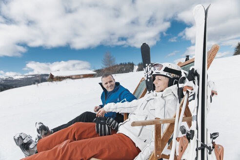 Germany, Bavaria, Winklmoosalm, Mature couple with skis relaxing in deckchairs - MFF000926