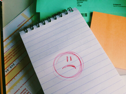 Sad Smiley on paper in office - MEAF000221