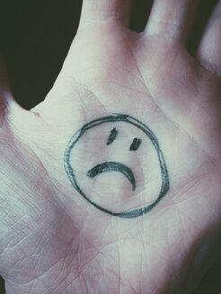 Sad Smiley on hand in office - MEAF000224