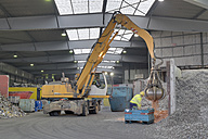 Excavator in a scrap metal recycling plant - LAF000845