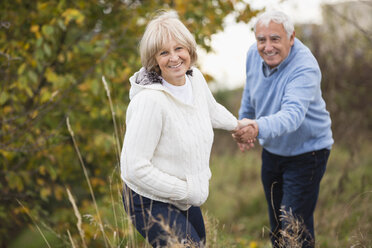 Smiling senior couple on the move - WESTF019225