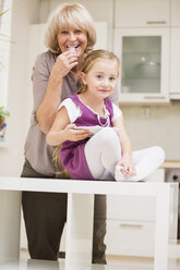 Little girl and her grandmother in kitchen - WESTF019126