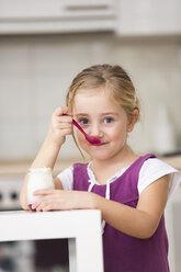 Portrait of little girl eating yogurt - WESTF019118