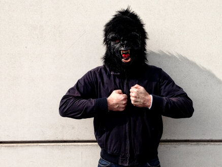 Germany, Berlin, man with gorilla mask - TKF000317