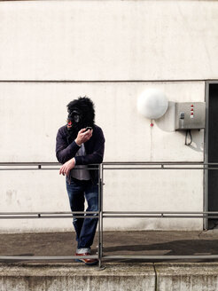 Germany, Berlin, man with gorilla mask - TKF000321