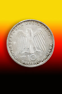 Old German commemorative coin in front of national colours - CS021081