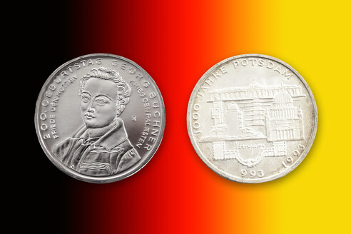 Two German commemorative coins in front of national colours - CSF021077