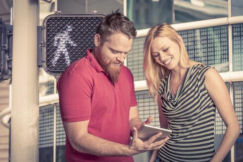 USA, Texas, Houston, young couple using digital tablet - ABAF001285