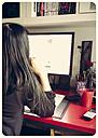 Woman at desk, rear view - SARF000405
