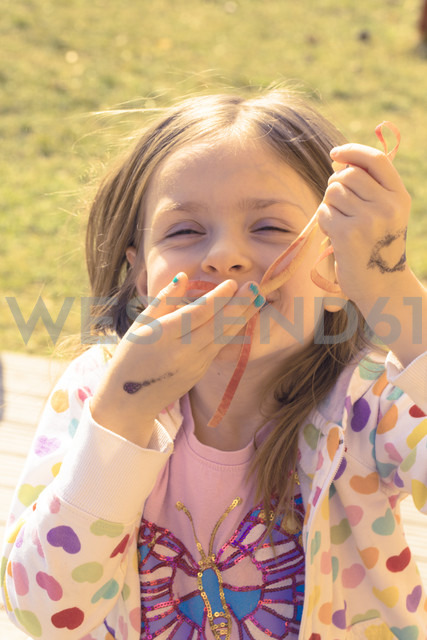Portrait of little girl with apple peel - SARF000421