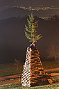Austria, Vorarlberg, Rhine Valley, Viktorsberg, wood tower with witch for bonfire - SIEF005198
