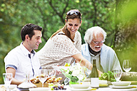 Three people on a garden party - ABF000541