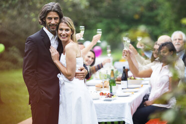 Bride and groom on a garden party - ABF000599
