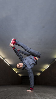 Germany, portrait of young break dancer in underpass - STS000372