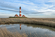 Germany, Schleswig-Holstein, North Sea Coast, View of Westerheversand Lighthouse in the evening - RJ000060