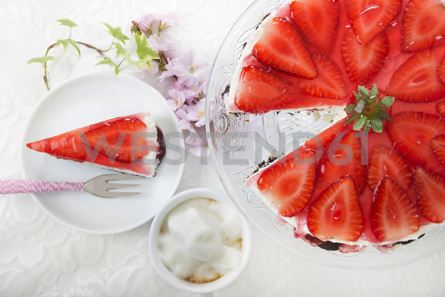 Strawberry cream cheese tart on cake stand and slice of strawberry cream cheese tart, elevated view - CSTF000190