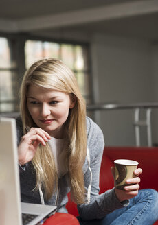 Portrait of young woman using laptop - UUF000004