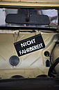 Sign hanging in old car, partial view - ELF000925