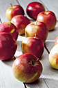 Braeburn apples on grey wooden table - CSF021099