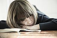 Girl lying on opened book - LVF000953
