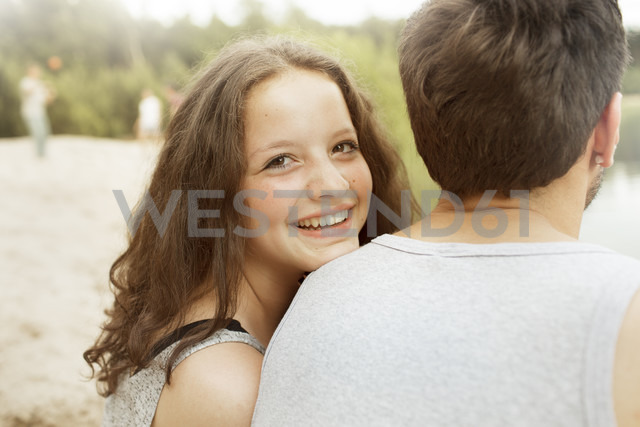 Young couple having fun at quarry pond - MUMF000014