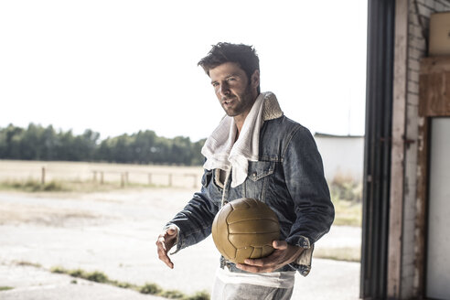 Portrait of man holding football - MUMF000028
