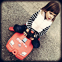 Germany, Baden-Wuerttemberg, girl with fire truck - LV000973