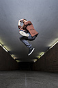 Young breakdancer jumping in the air in underpass - STSF000392