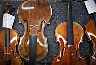 Violins to be repaired in a violin maker's workshop - DIKF000086