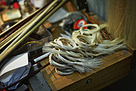 Tools and horsehair for the bows in a violin maker's workshop - DIKF000097