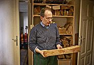 Violin maker choosing wooden material - DIKF000101