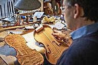 Violin maker at work in his workshop - DIKF000107