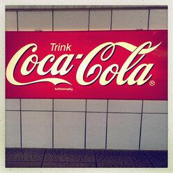 Coca-Cola advertising, illuminated front of a house in Hamburg, Hamburg, Germany - MS003674